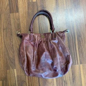 tory brown brown and gold purse